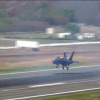 Blue Angel pilot practicing a low-altitude, high performance takeoff over a lake